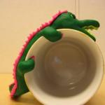 guldmugg grön krokodil